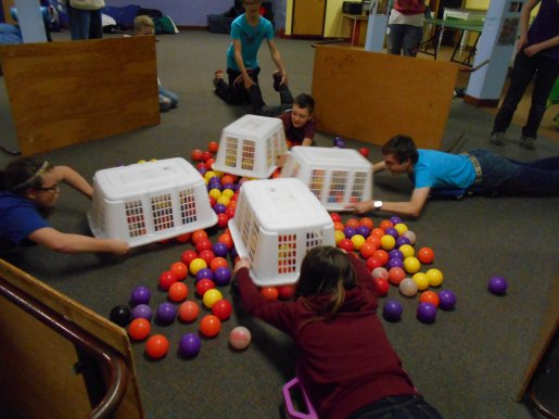 youth play Hungry Hippo game