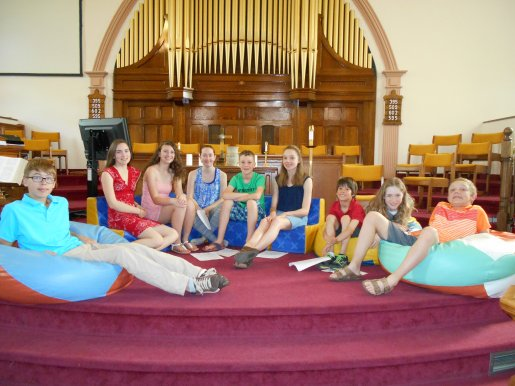 youth at front of church on bean bag chairs